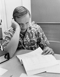 Neil Armstrong reviews flight plans.jpg